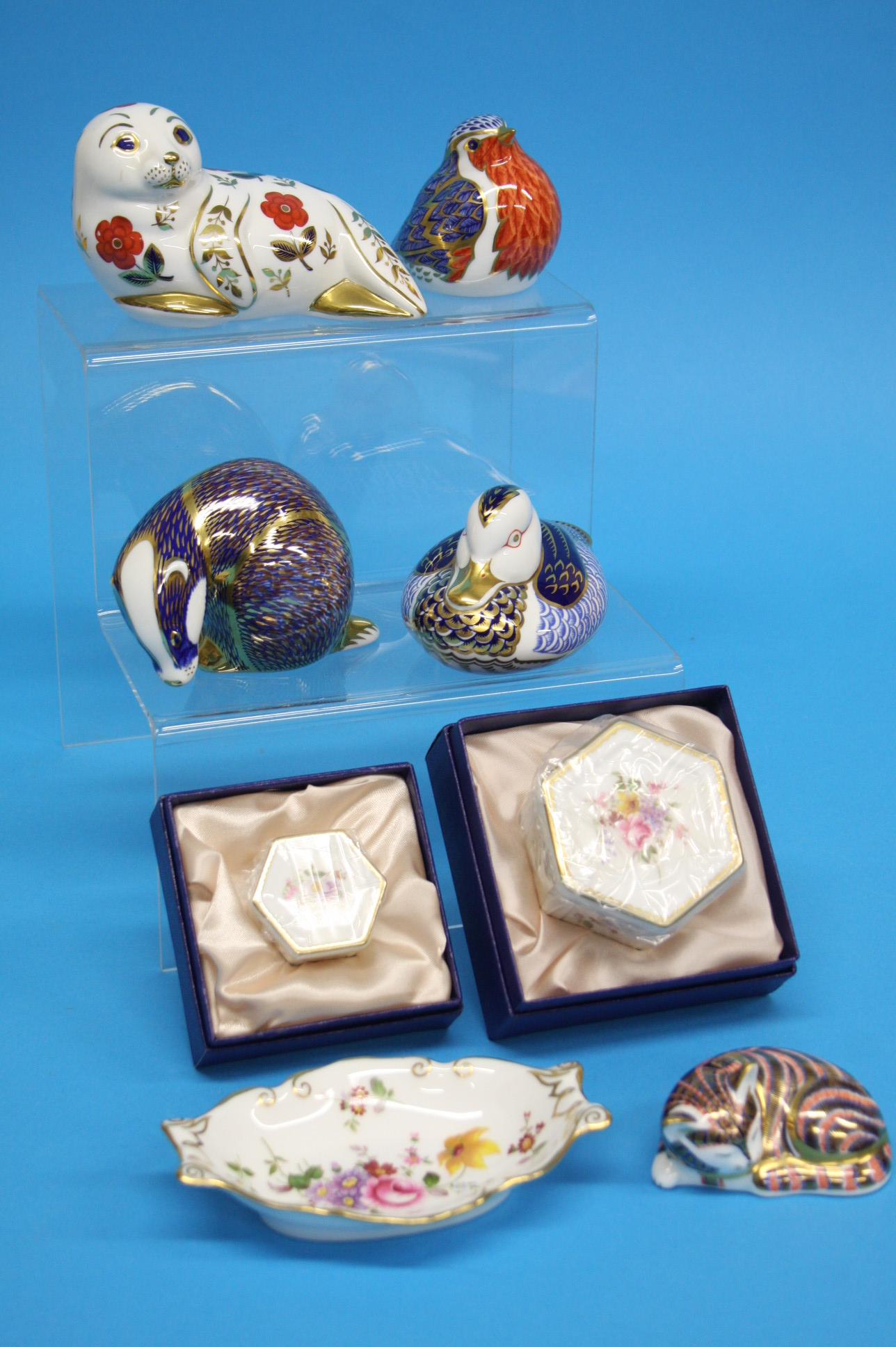 A collection of five Royal Crown Derby paperweight