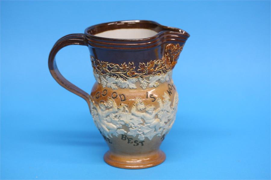 A Royal Doulton stoneware Bacchus jug 'Good is not
