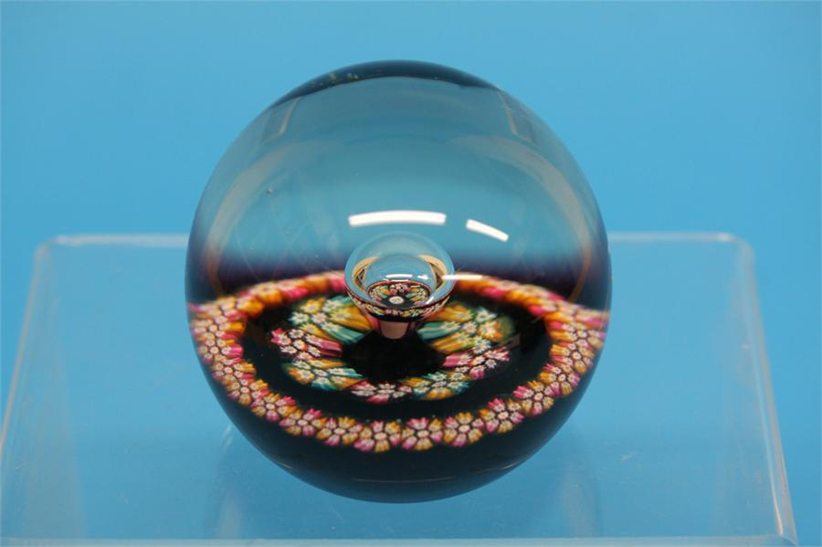 A boxed Caithness 'Myriad' paperweight