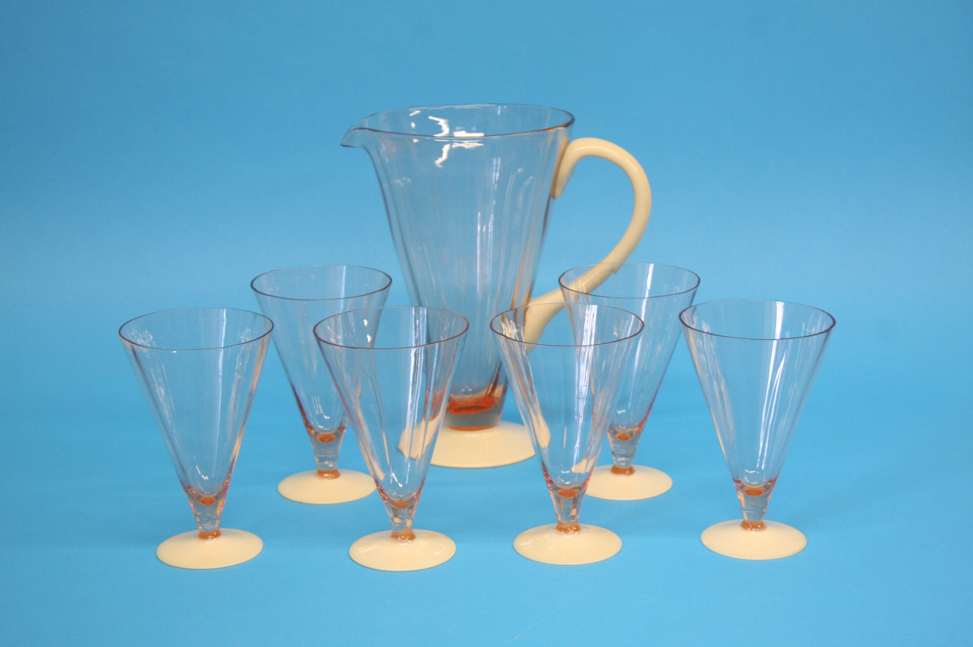 A juice set comprising conical jug and six juice g