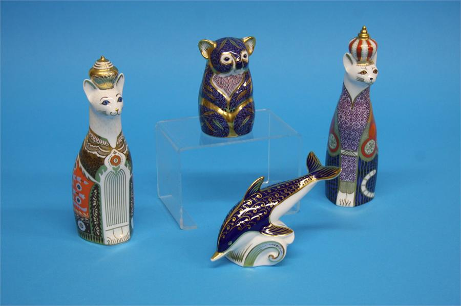A collection of four Royal Crown Derby paperweight