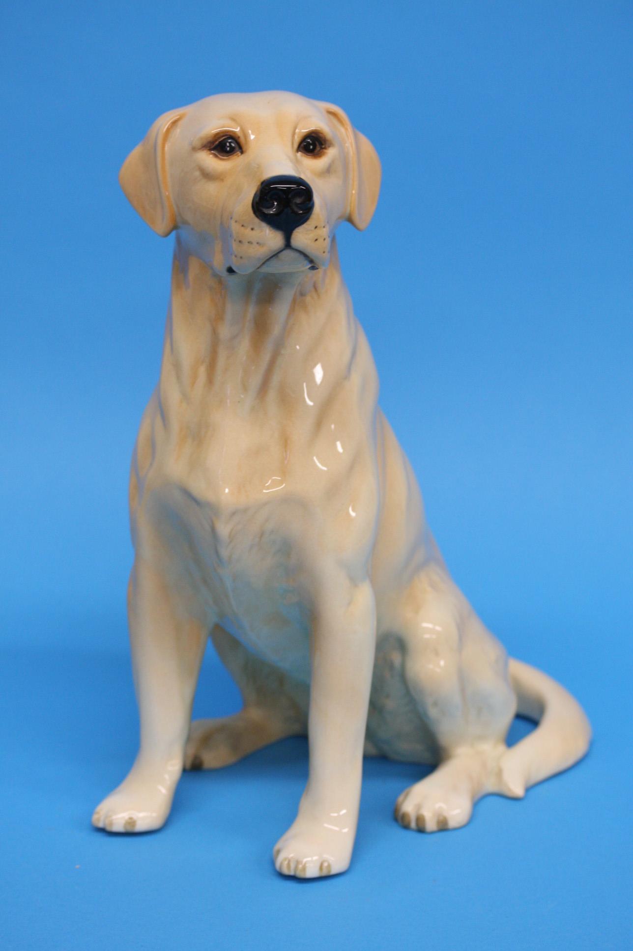 A Beswick seated fireside golden Labrador, black p