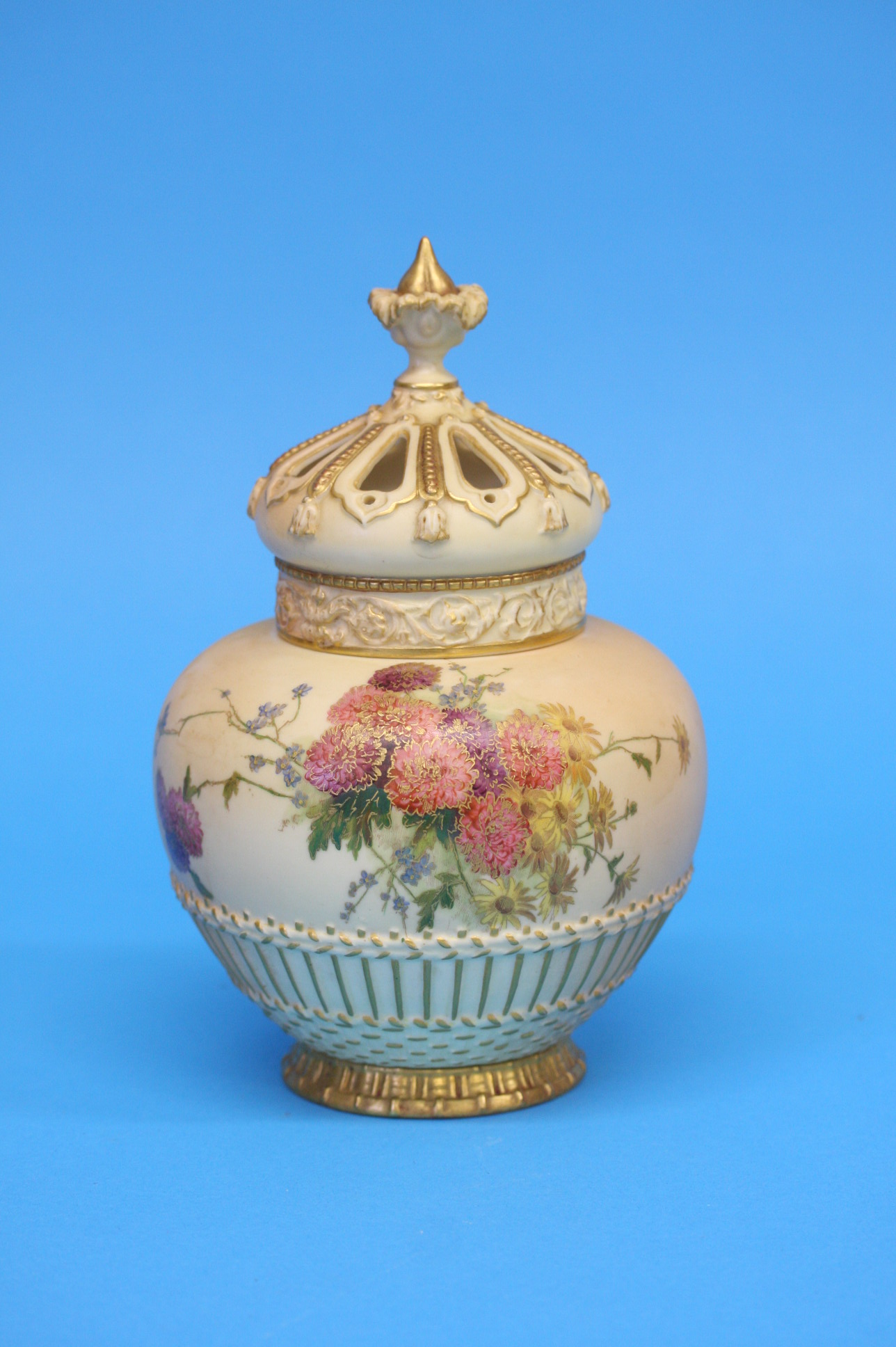 A Royal Worcester vase and cover decorated with ch