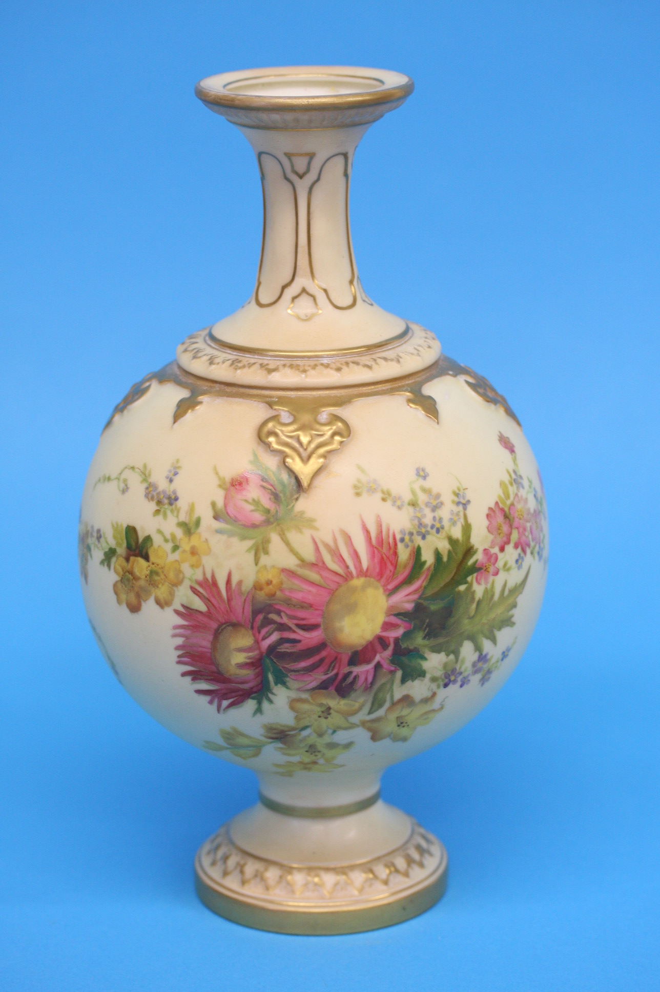A Royal Worcester vase decorated with holly leaves