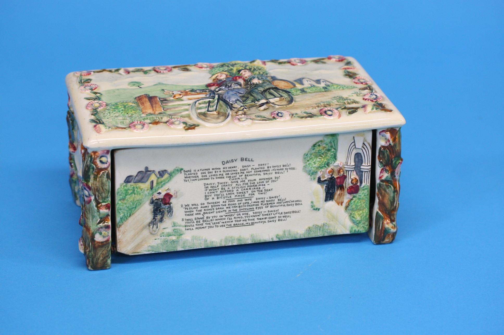 A Crown Devon 'Daisy Bell' musical box, 21cm lengt
