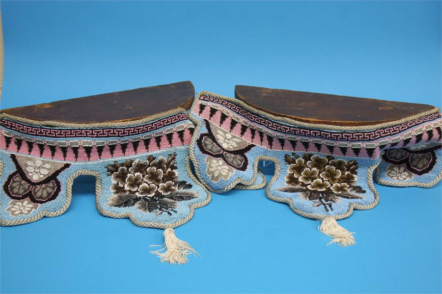 A Pair of half moon hanging wall shelves with shap