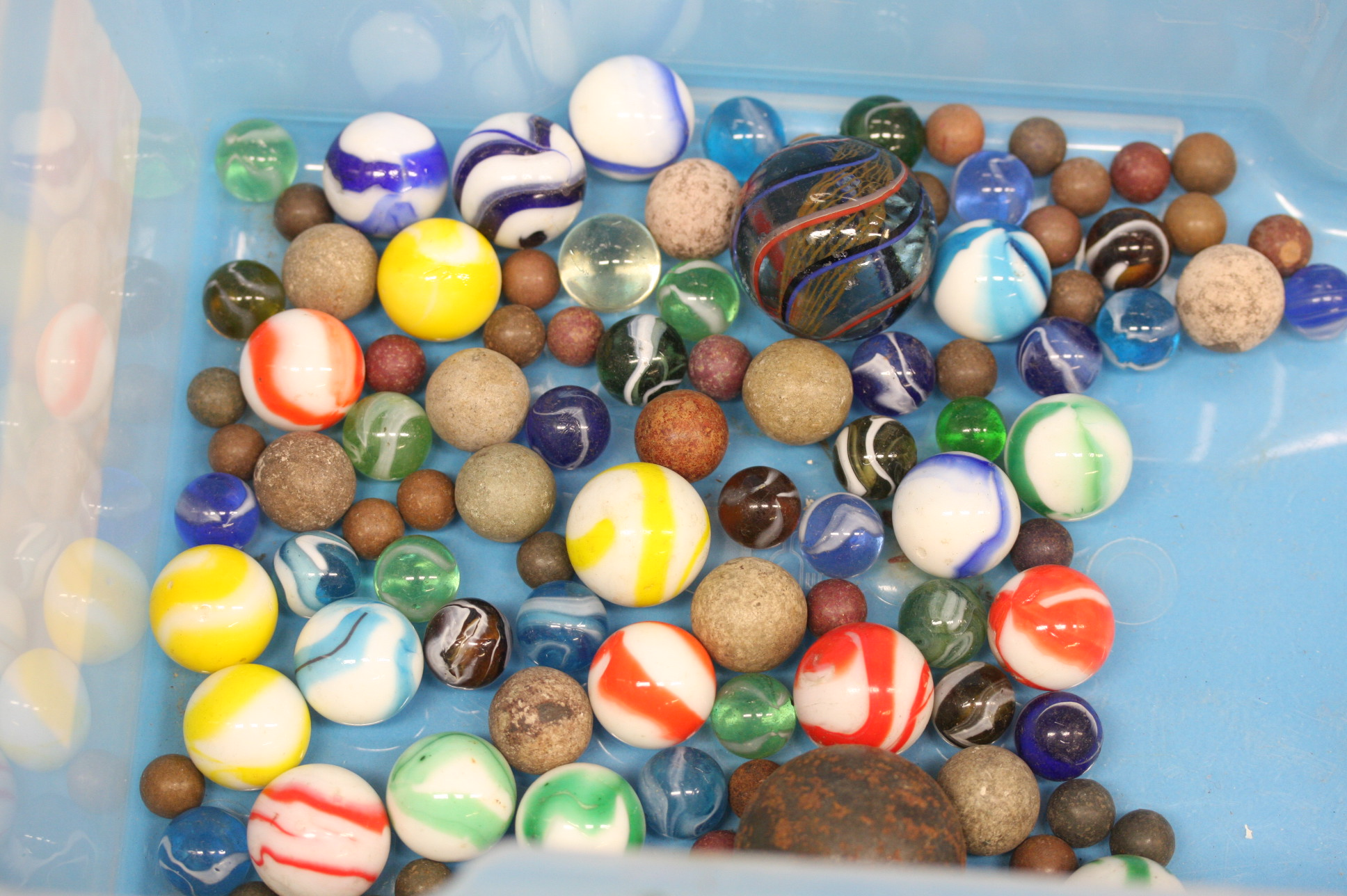 A collection of old coloured marbles