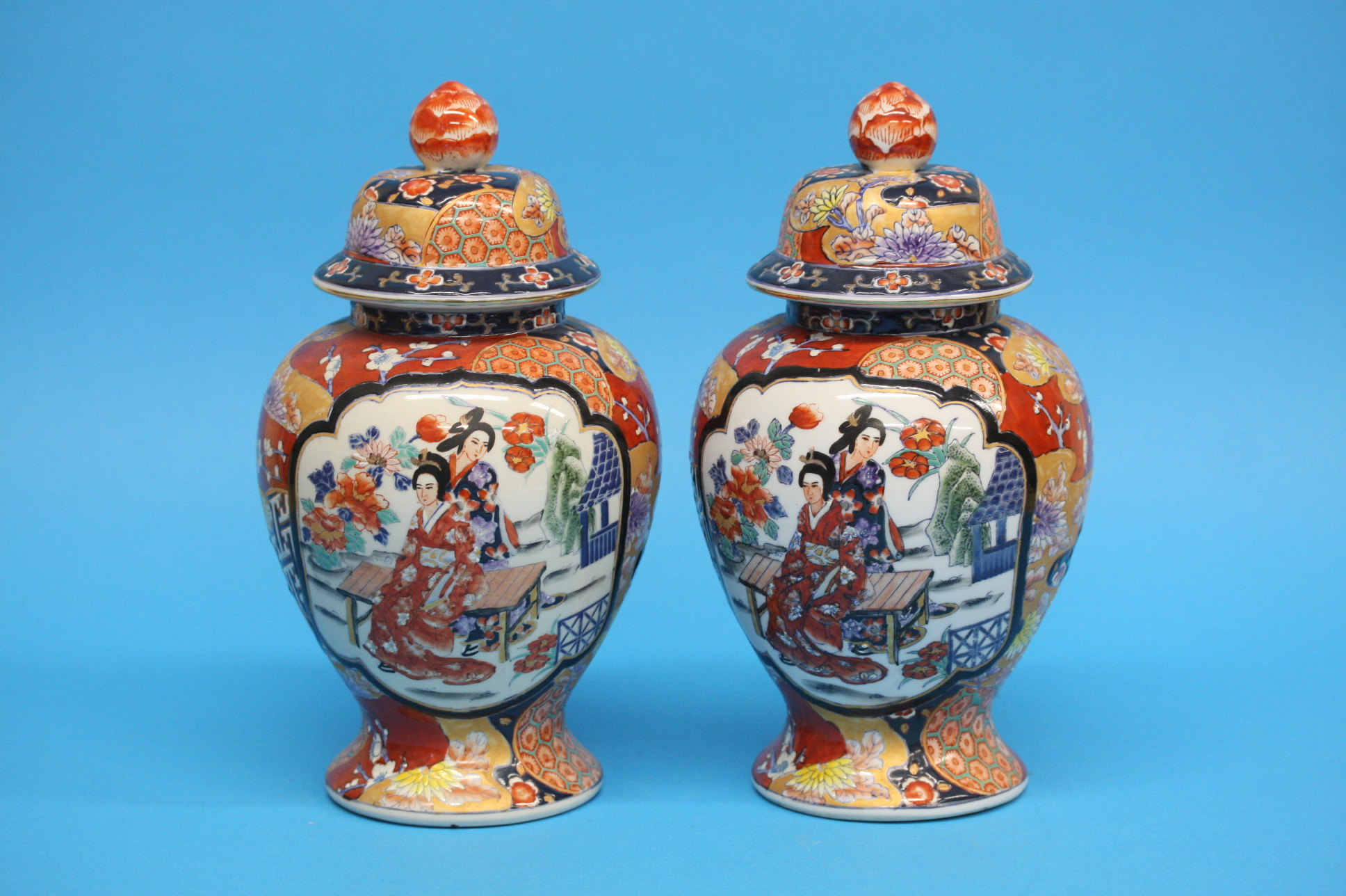 A pair of modern Oriental ginger jars and covers,