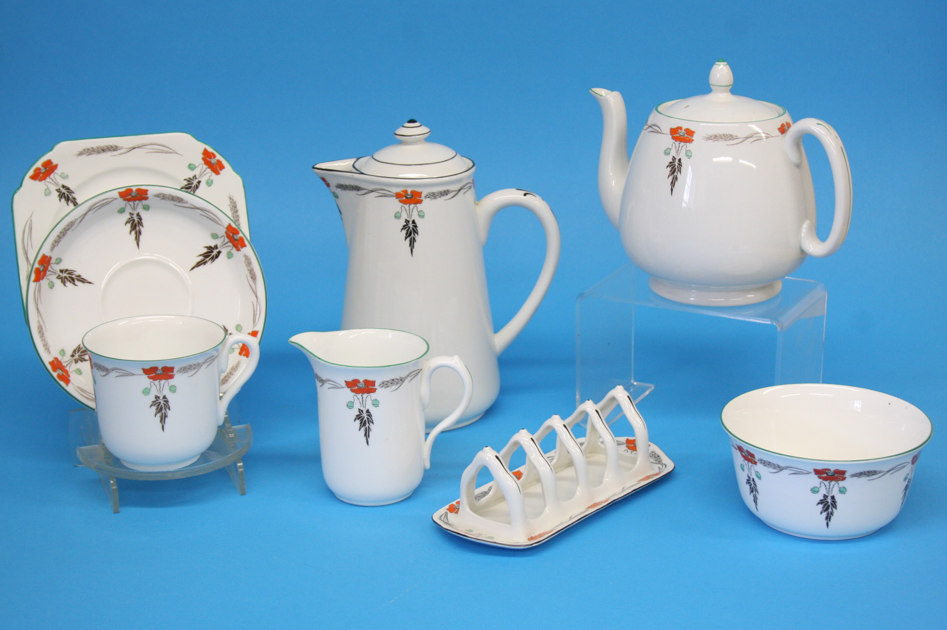 A Shelley tea and coffee service decorated with fl