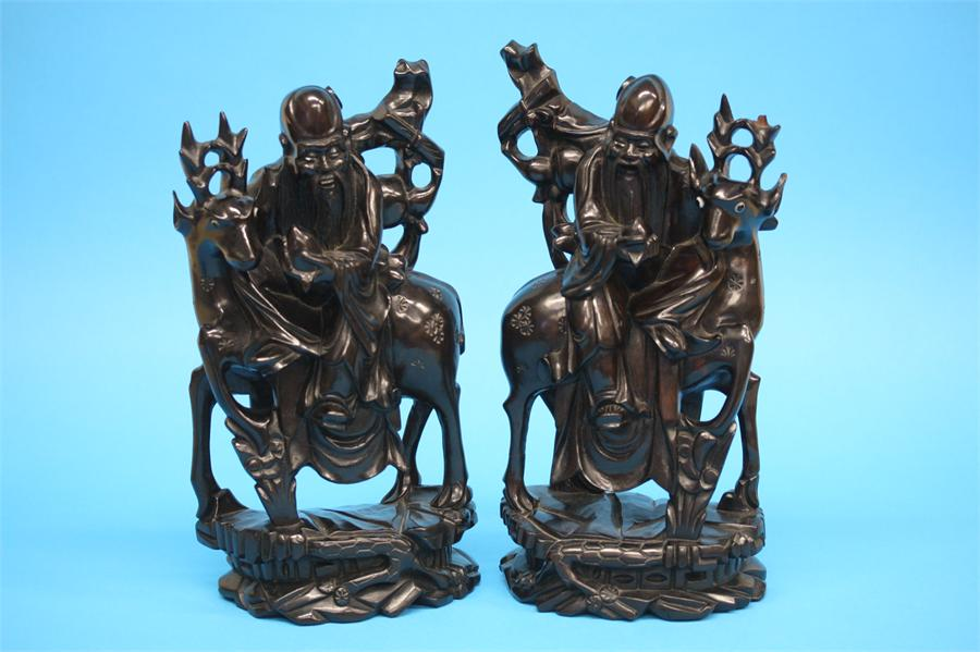 A pair of modern Chinese hardwood Immortals, 32.5c