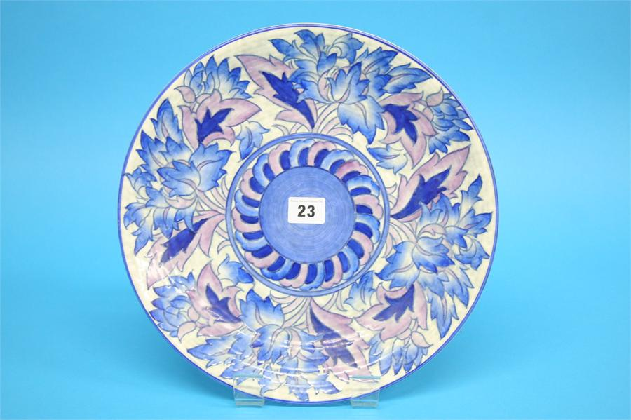 A Crown Ducal wall plate with stylised floral bord