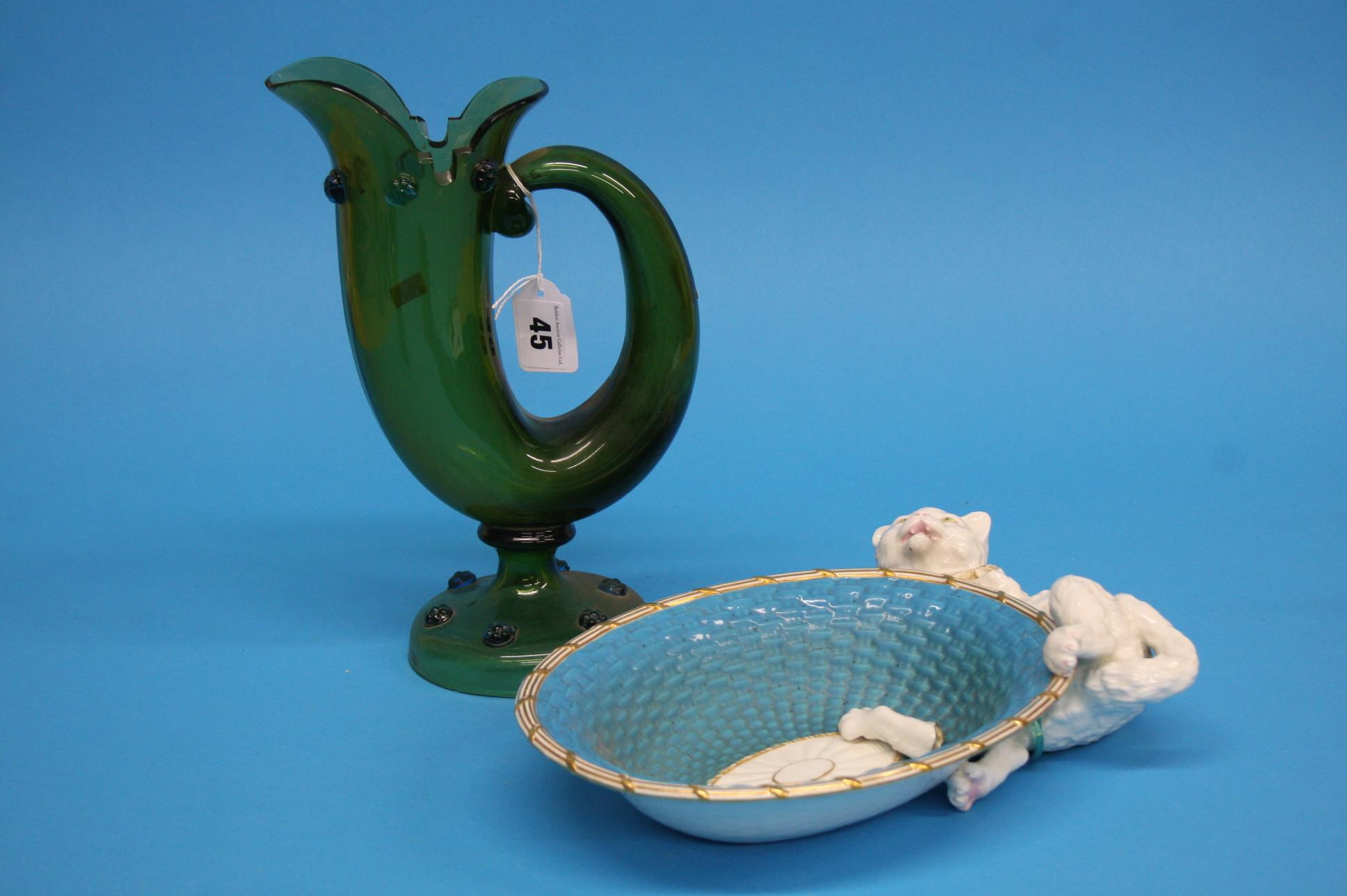 A Continental green glass horn shaped jug, 26cm he