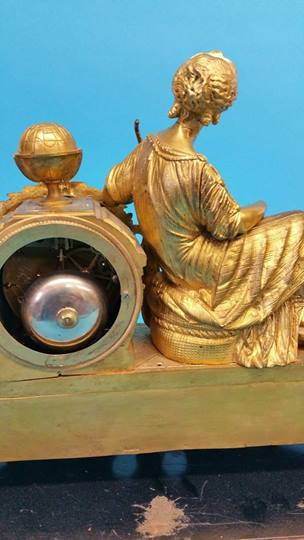 Lot 22 - A Continental gilt metal mantel clock with white e