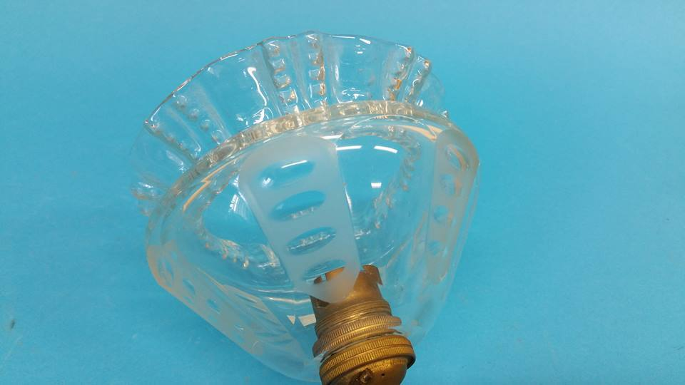 Lot 33 - A single light scrolling wall sconce with clear gl