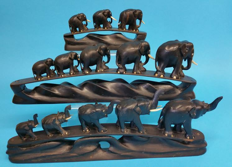 Lot 20 - Three carved ebony elephant chains