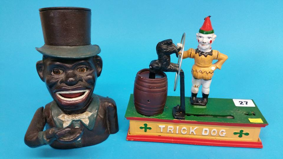 Lot 27 - A money box 'Trick dog' and a cast iron African Am