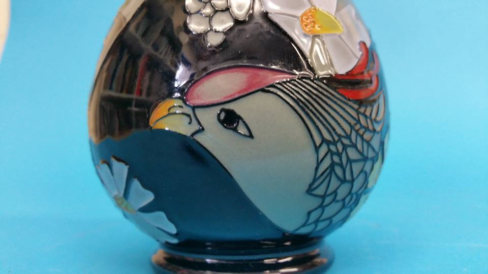 Lot 32 - A modern Moorcroft vase, decorated with stylised f