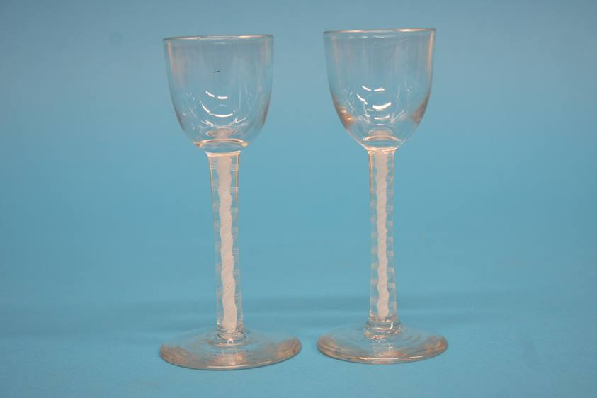 Lot 9 - Two Victorian sherry glasses with bell shaped bowl and double opaque air twist stems, 11cm height