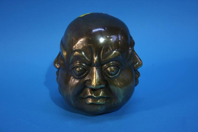 Lot 35 - A four faced brass Buddha's head