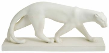 An Art Deco style pottery model of a panther in walking pose on a rectangular base, mark to base