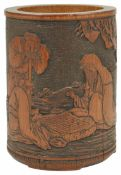 A 19th century Chinese carved bamboo brush pot carved with a scene of two seated figures playing Go,
