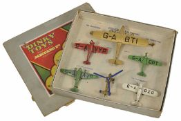 Set of six Dinky aeroplanes in original box numbered 60. One large gold aeroplane, Imperial
