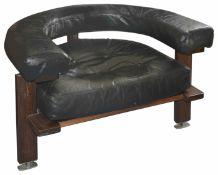 Esko Pajamies , a rosewood and black leather Polar chair