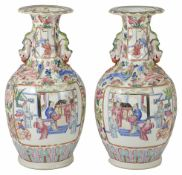 A pair of 19th century Canton famille rose baluster vases painted in the traditional palette with