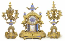 A French gilt clock garniture the clock with circular dial with Roman numerals, mounted with an