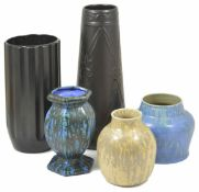 A Ruskin cream glazed vase dated 1927 together with a Belgian urn shaped vase, a tall black Athens