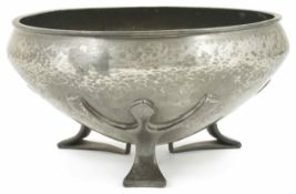 A Liberty Tudric pewter bowl with inverted rim, raised on three stylised feet, stamped on the