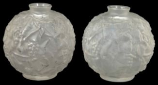 A pair of Sabino Art Deco frosted glass vases each of globular form with stylised leaf and berry