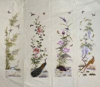 A Japanese embroidered four section panel circa 1900 each section embroidered in coloured silk floss
