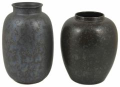 A Poole pottery vase of elongated ovoid form with matt glaze decorated with a random iridescent