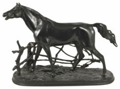 A late 20th century Russian cast iron model of a thoroughbred realistically modelled standing