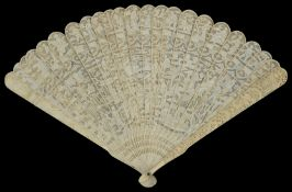 An early 20th century Chinese Canton carved ivory fan finely carved and pierced to front with