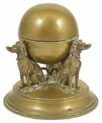 An usual novelty brass late 19th/early 20th century inkwell with three cast seated dogs looking