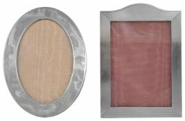 Two silver frames one of oval form, the other rectangular portrait, both with easel backs the