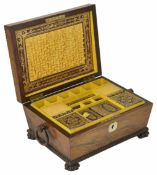 A late mahogany sewing box of sarcophagus form with ring handles to the side, the lid opening to