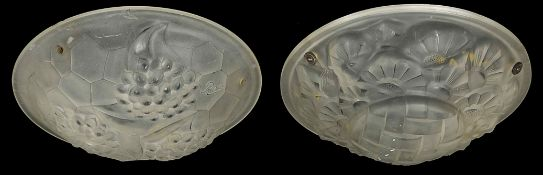 A pair of plaffioniers of circular form with mounded decoration of flowers and fruit Condition: Some