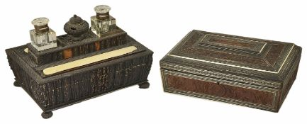 A 19th century horn veneered desk stand and another with two glass inkwells and central horn ink