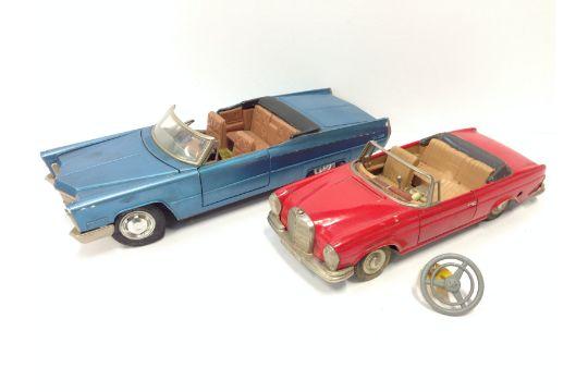 two schuco (germany) plastic cars: 5505 cadillac de ville