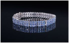 AA Tanzanite Three Row Bracelet, 27.5cts of oval cut tanzanites, closely set in three rows in