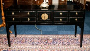 A Modern Highly Polished and Stylish Black Lacquered Sideboard with 4 small drawers to either side