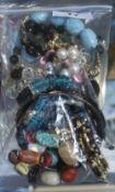 Bag of Costume Jewellery Bracelets, beaded, faux gem set and a bangle etc