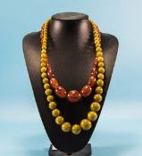 A Vintage Pair of Bead Necklaces. Lengths 22 and 28 Inches.