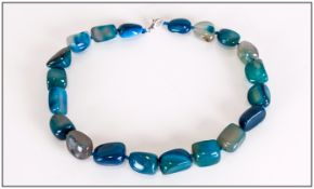 Teal Blue Agate Necklace, a strand of smooth tumbled agate beads, hand knotted on blue silk and