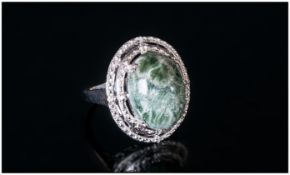 Siberian Seraphinite Ring, an oval 8ct cabochon of the unusual olive green stone with silvery