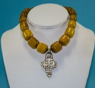 A Vintage Amber Necklace with White Metal Pendant Drop. 14 Inches In Length.