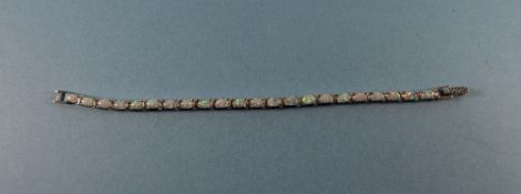 A Silver Line Bracelet Set with Opals ( 22 ) Opals In Total. Marked 9.25. 7.5 Inches Long.